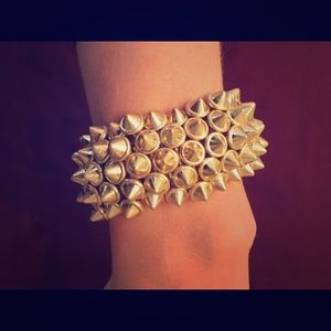 Urban Outfitters gold spikey statement bracelet.